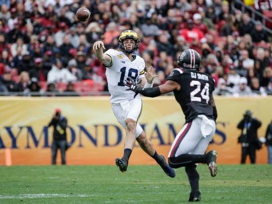 Michigan Wolverines quarterback Brandon Peters passes