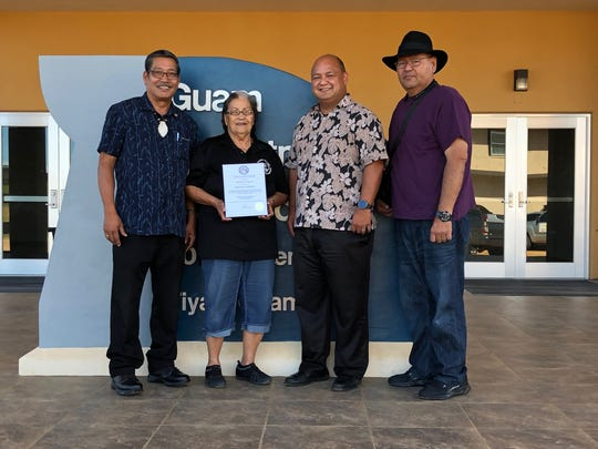 Senator Joe S. San Agustin presented Guam Dept. of Education community program aide Magdalena Duenas with a certificate of appreciation for her 26 years of dedicated service with the department on Feb. 8 at DOE's Tiyan office. Pictured from left: San Agustin, Duenas, GDOE Superintendent Jon Fernandez and Guam Education Board member James Lujan.
