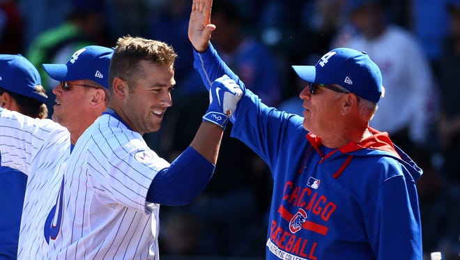 Chicago Cubs third baseman Mike Olt (left) celebrates with manager Joe Maddon after hitting a two run home run in the second inning against the Oakland Athletics during a spring training baseball game at Sloan Park.