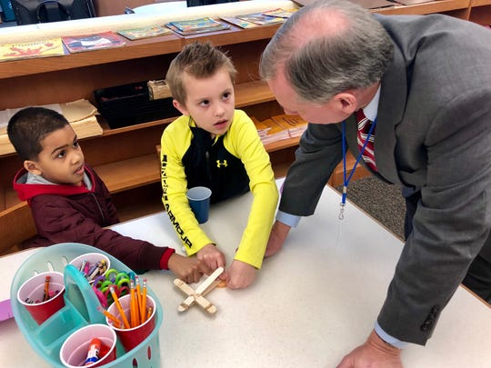 Sen. John Eichelberger Jr. (right) works with second-graders Joseph Vasquez (left) and Jacob Shong (middle) on building a catapult during a STEM lesson the morning of Monday, March 5 at Hamilton Heights Elementary School in Chambersburg.