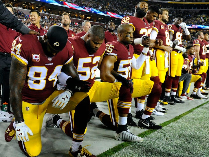Washington Redskins players kneel at FedEx Field in