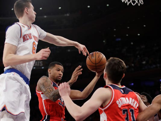 Washington Wizards' Trey Burke (33) drives past New York Knicks' Kristaps Porzingis (6) during the first half of an NBA basketball game Thursday, Jan. 19, 2017, in New York. (AP Photo/Frank Franklin II)