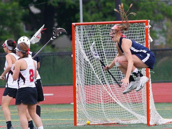Pittsford's Megan Plain, right, leaps for joy as she scored the game-winning goal with just :03 seconds left in double overtime during Section V Class A Championship girls lacrosse action between Penfield Patriots and Pittsford Panthers at Eastridge high school in Irondequoit Wednesday evening, May 28, 2014. Pittsford upset top seeded Penfield, 10-9, in double overtime.
