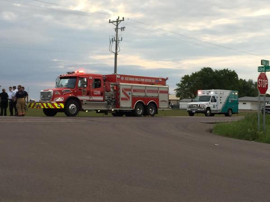 Fire truck and ambulance on scene near where a body was found Thursday in a field in southwestern Sioux Falls.