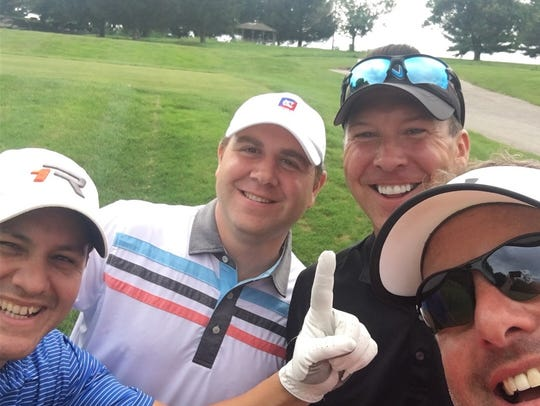 Jim Powers with his playing partners last Friday at