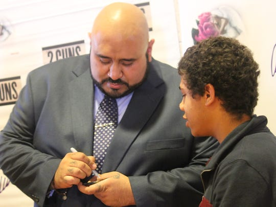 Jesus Payan Jr. took time after his presentation to