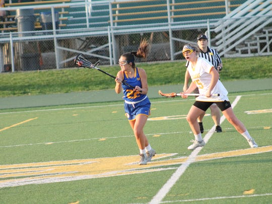 Mariemont junior Courtney Robinson pursues the goal while being chased by Renee Foster of Sycamore.