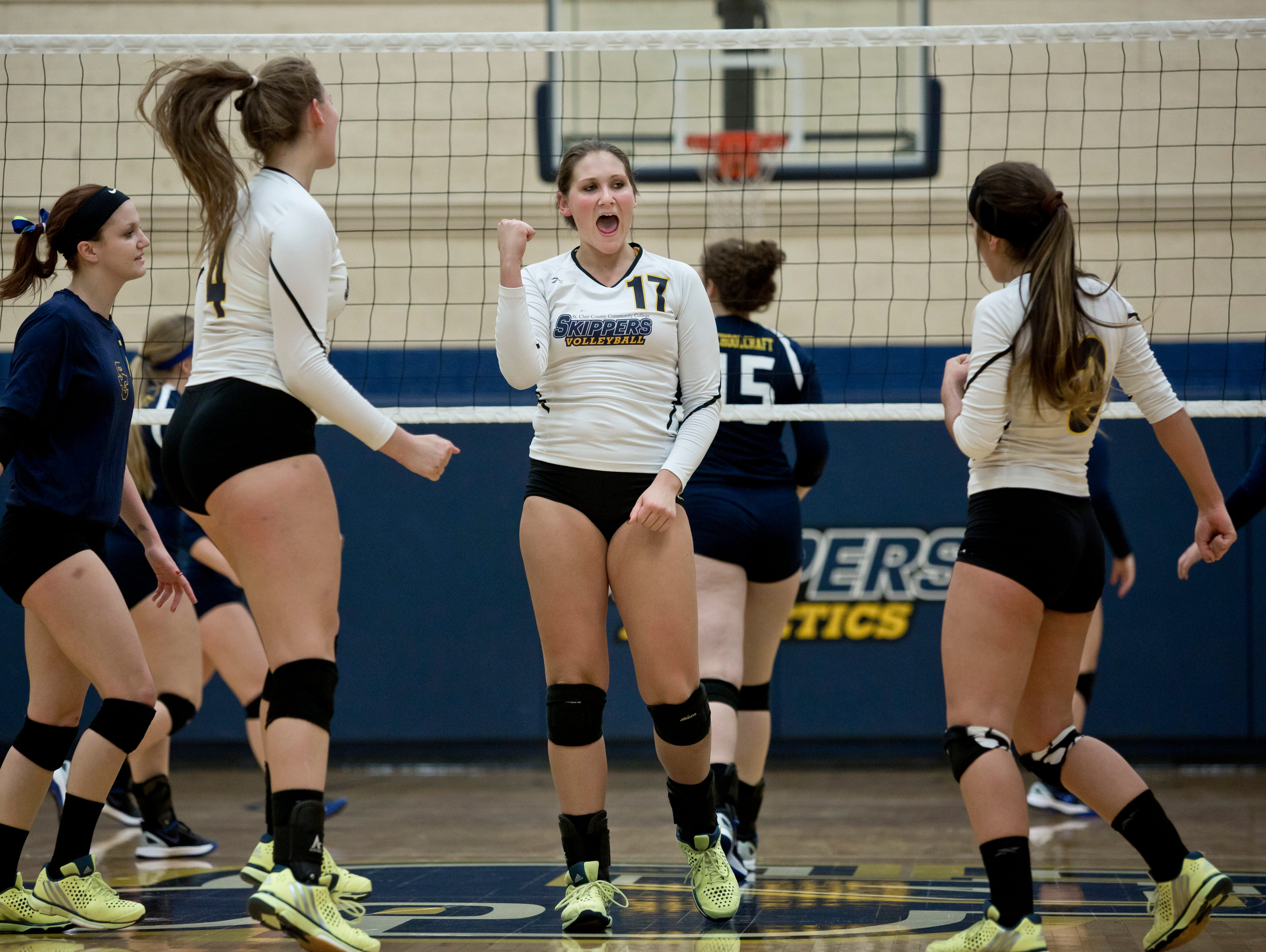 SC4's Briann Alspaugh celebrates with teammates during a volleyball game Tuesday, October 21, 2015 at the St. Clair County Community College gymnasium.