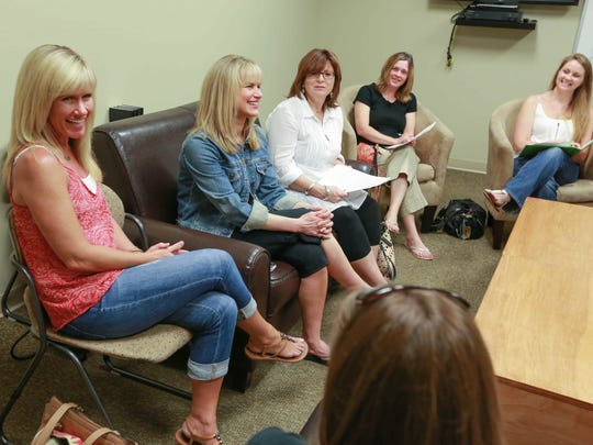 Stripped Free founders Stefanie Jeffers (far left) and Kim Tabor (near left) update prayer team members from Mount Pleasant Christian Church, including  Lori Braun, LaDonna Jobst and Amy Burchett, on girls they pray for during prayer meetings, June 4, 2015.