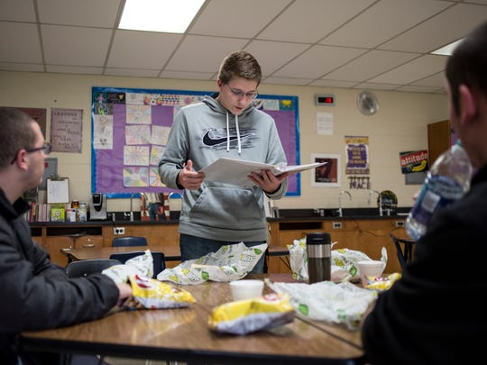Justin Brack, 16, goes over fundraising ideas for the River Rec Teen Zone during lunch Friday, April 22, 2016 at Riverview East High School in Marine City.