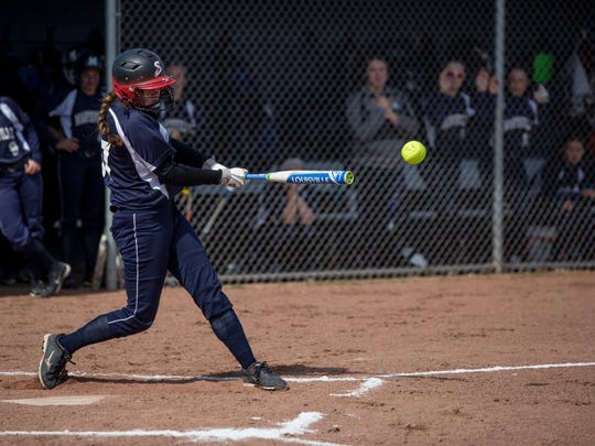 Marysville's Paige Ameel gets a hit during a softball game Tuesday, May 17, 2016 at Marysville High School.