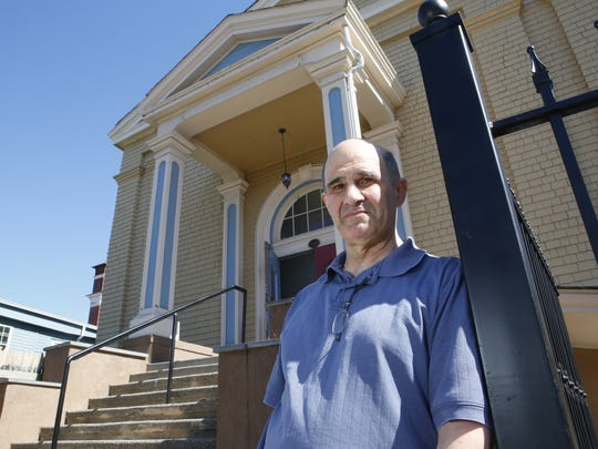 Larry D'Amico in front of the former church and library on South Street in Peekskill