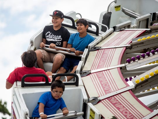 Evangelo Soney, 14, and Dayton White, 13, of Walpole Island, enjoy a ride with friends during the Algonac Lions Pickerel Festival Friday, July 1, 2016 in Algonac. The festival continues through July 4.