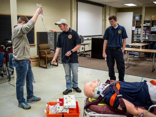 Paramedic trainees Andrew Booms, 23, Brad Roff, 25,