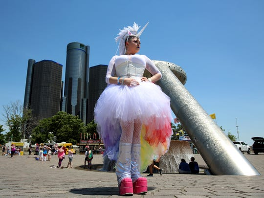 Lauren Harlow, 31 of Dearborn Heights came to the Motor City Pride Festival at Hart Plaza in Detroit on Saturday, June 10, 2017 in a rainbows and unicorn's outfit she made.