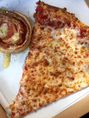 A slice and a pepperoni roll from Don Anthony's Pizza