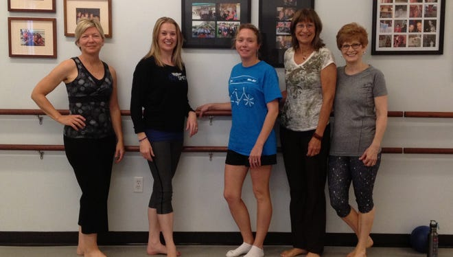 Reporter Jackie Rehwald hit the barre Tuesday morning with these gals. Pictured from left are Cindy Shannon, instructor Caroline Richardson, Rehwald, Teresa Hardin and Linda Loveland.