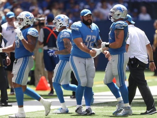 Lions defensive lineman Haloti Ngata greets players