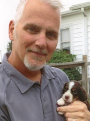 Bill Bryant with Riley as a puppy in early 2013. Bill died from cancer in 2015.