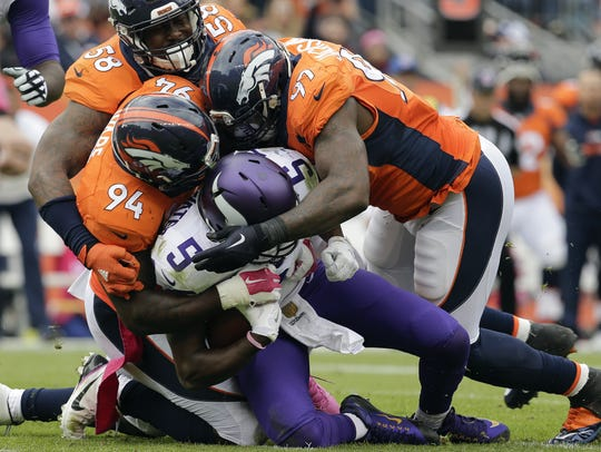 Vikings quarterback Teddy Bridgewater (5) is sacked