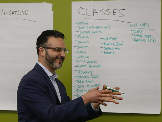 "Zach Mannheimer of Iowa Business Growth leads a ""visioning"" session in May 2016 with residents of Fort Dodge to brainstorm what amenities they most want for their city."