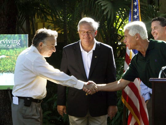 Florida Gov. Charlie Crist, second from right, shakes hands with U.S. Sugar Corp. CEO Bob Buker after announcing the state has reached a deal to buy land from the company.