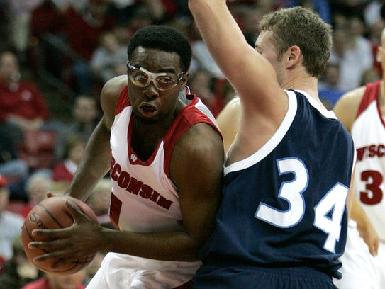 Wisconsin's Marcus Landry tries to get around the block