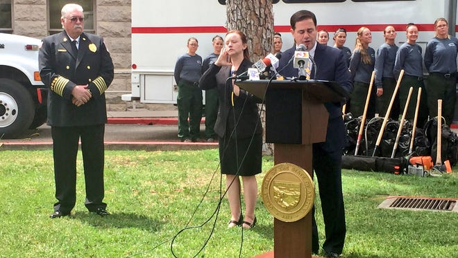 Gov. Doug Ducey speaks to the media on Tuesday after being briefed by fire officials on potential dangers of the wildfire season.