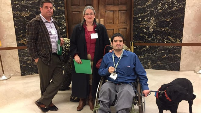 Dan Kluis, board president of Rowell Family Empowerment, Wendy Longwell and her son Derek Longwell on a visit to the state capitol in February.
