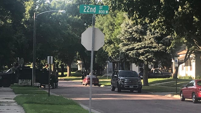 Sioux Falls Police surround a building in central Sioux Falls Thursday night. Officers over loudspeaker asking for occupants to exit.