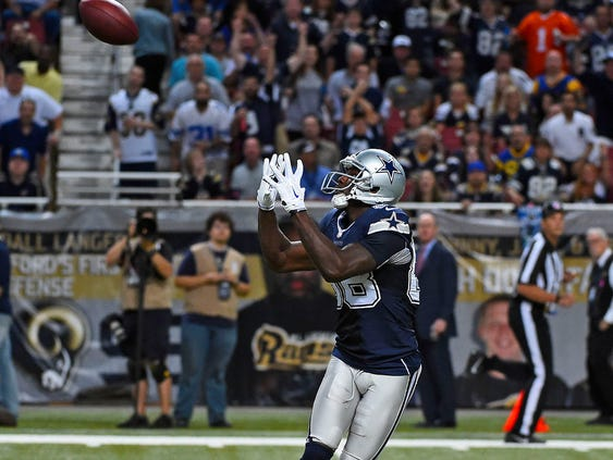 Dallas Cowboys wide receiver Dez Bryant (88) catches a pass from quarterback Tony Romo (not pictured) to score a touchdown against the St. Louis Rams during the second half at the Edward Jones Dome in St. Louis on September 21, 2014.
