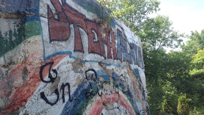 Members of the Sturgeon Bay Class of 2001 raised $2,000 at gofundme.com in a matter of days to restore the memorial they painted after their classmates Stephanie Starr and Alaya Serafico died early in their senior year.