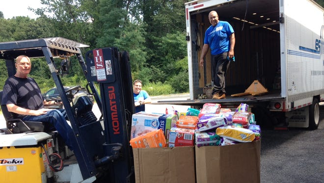 The Westchester Coalition for the Hungry and Homeless donated 50,000 diapers to the new Westchester County Diaper Bank. They were loaded into a Westchester County Department of Social Services warehouse in Elmsford in August.