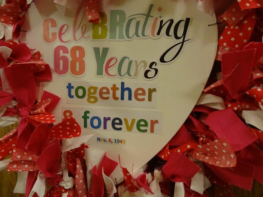 A heart-shaped wreath hangs on the front door of Dwight and Wilma Priode's home announcing the celebration of 68 years together.