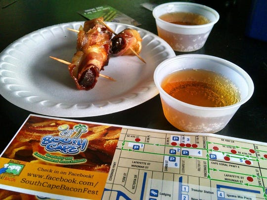 The Dek bar served bacon-wrapped sausage and beer samples during the 2014 BaconFest.