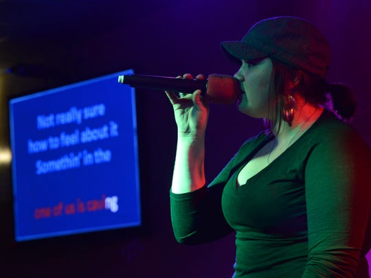 """Angel Griffin sings Rihanna's """"Stay"""" April 16 during a karaoke night at the Orange Carpet in downtown Lancaster."""