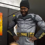 Raphael Brown tries on a Batman costume while shopping at the Spirit Halloween store with his son Henry on Thursday, October 20, 2016. The two were on their way to Zoo Knoxville's Boo at the Zoo.