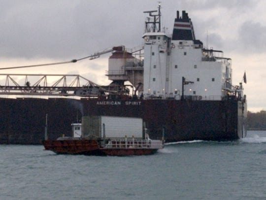 The Blue Water Ferry hauling a tractor-trailer is dwarfed
