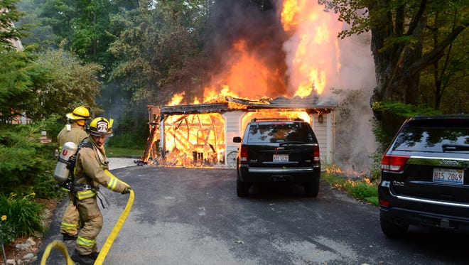 An unattached garage, vehicle and boat were destroyed by fire Sunday morning in Ephraim.
