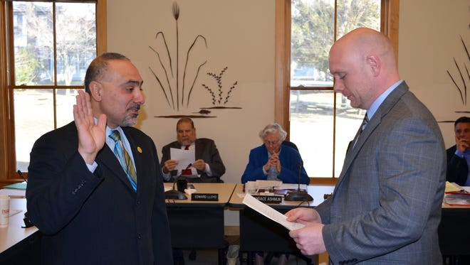 "Giuseppe ""Joe"" Chila, newest Pienlands Commission member, takes an oath of office  administered by Deputy Attorney General Sean Moriarty at Friday's meeting."