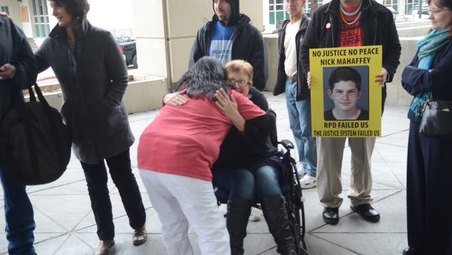 Kitty Colbert, 59, hugs a woman following a prayer circle Tuesday outside the Reno Justice Court. Colbert suffered multiple fractures after she was run over by a driver, identified as Nicholas Mahaffey. She is confined to a wheelchair and undergoes physical therapy three times a week.