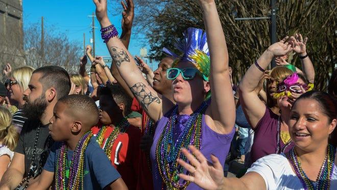Pensacola Grand Mardi Gras Parade rolls in downtown Pensacola.