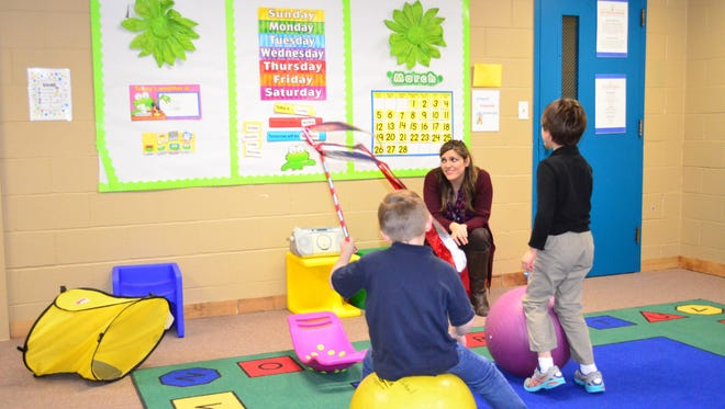 Teacher Vasti Witt watches Grayson Rietzke and Dalton Tippitt play in the Jumpstart kindergarten class at Edison School.