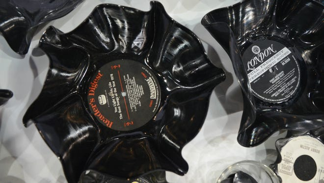 Bowls made out of vinyl records on display Wednesday at the Generation E Institute's 12th Annual Student Business Showcase at Kellogg Arena in Battle Creek. The bowls were created by Coldwater High School student Skyy Atwell.