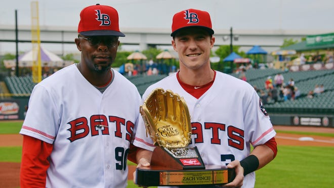 Zach Vincej was honored with the 2016 Minor League Baseball Gold Glove award for his play at short stop last season. He's here pictured with Bats manager Delino Deshields.