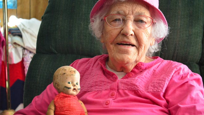 Earline Hughes holds a doll once owned by her son, one of her roughly 800 collected dolls.