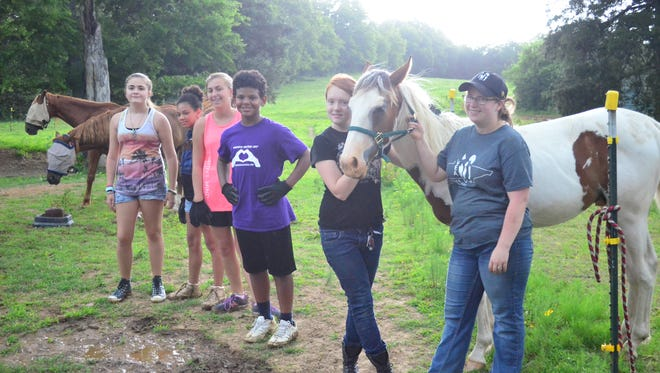 Young volunteers with Sumner Teen Center helped horses with Volunteer Equine Advocates.
