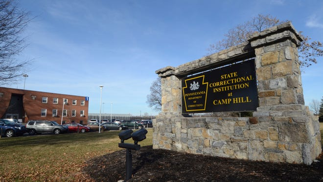 Shown is the the front sign at the State Correctional Institution at Camp Hill, Pennsylvania, where a newly cleared wing is set to house inmates from other prisons that could close, Friday, Jan. 13, 2017, in Camp Hill, Pa. (AP Photo/Marc Levy)