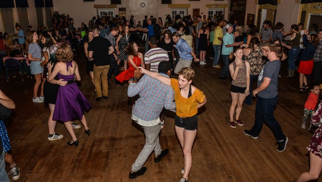 Dancers strut and jive during a weekly swing dance on Friday, Aug. 11, 2017, at the American Legion Post 33 in Pensacola.
