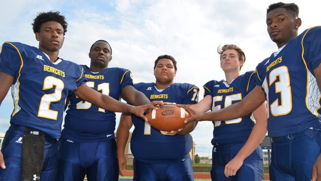 Returning senior leaders for the Battle Creek Central football team include, from left, Antonio Postell, Cedrion Pierce, Cristian Miller, Nick Enos and Darrell Banks.